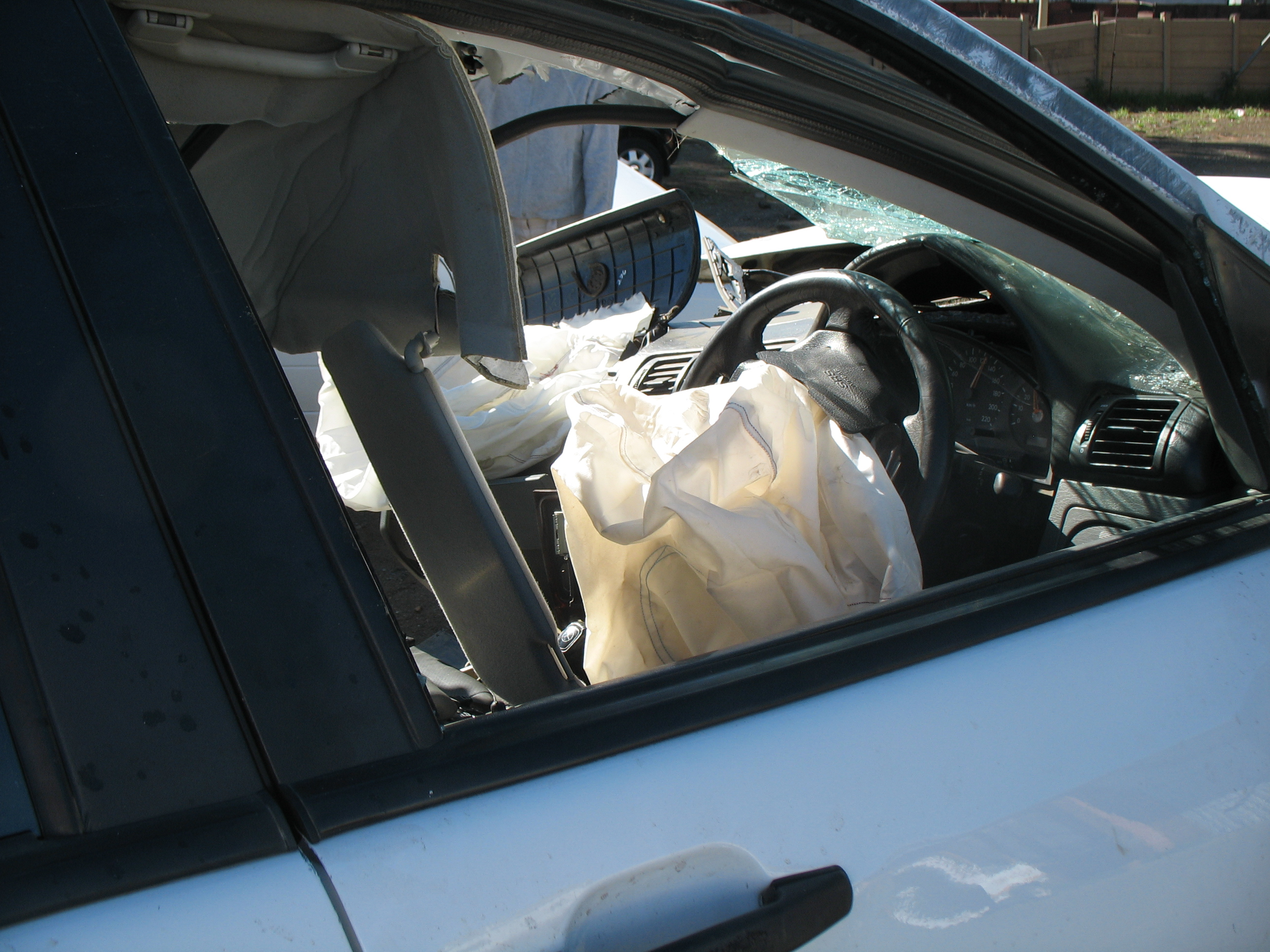 Models with SRS airbags and lapshoulder restraints for driver, front passenger, and window-side rear passengers