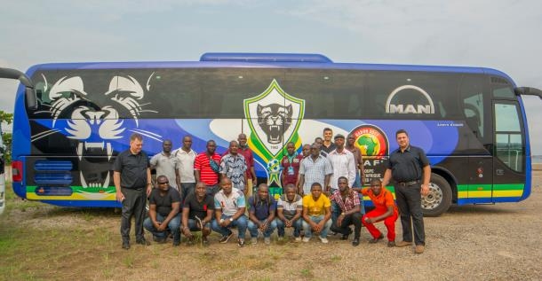 l-r-profidrive-trainers-denis-rigot-jimmy-el-khoury-as-well-as-burak-keskinkilic-head-of-bus-sales-at-the-man-center-importer-nwc-africa-in-front-of-the-team-bus-458325